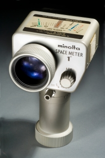 Studio photograph of Apollo 11 One Degree Minolta Spotmeter (A19980022000) against a grey background, February 11, 20098. This light meter was used by Apollo 11 astronauts to set their camera exposures accurately in the stark lighting conditions of space.